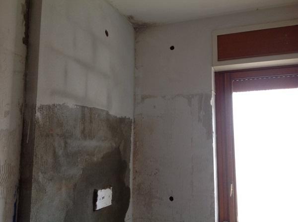 Isolamento casa. Insufflaggio muri perimetrali. Tortona, Alessandria.
