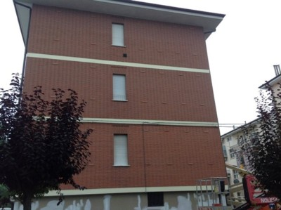 Isolamento condominio. Insufflaggio muri perimetrali. Alba, Cuneo.