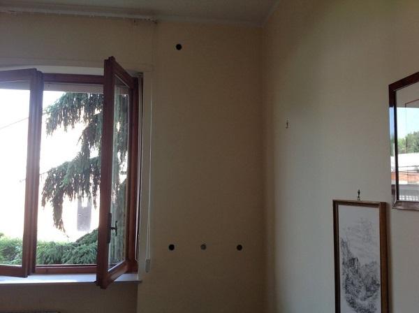 Isolamento ufficio. Insufflaggio muri perimetrali. Alessandria.